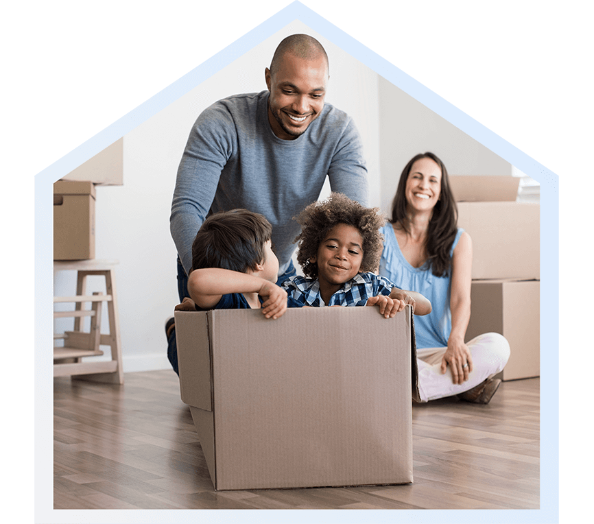 Interracial family playing with moving boxes