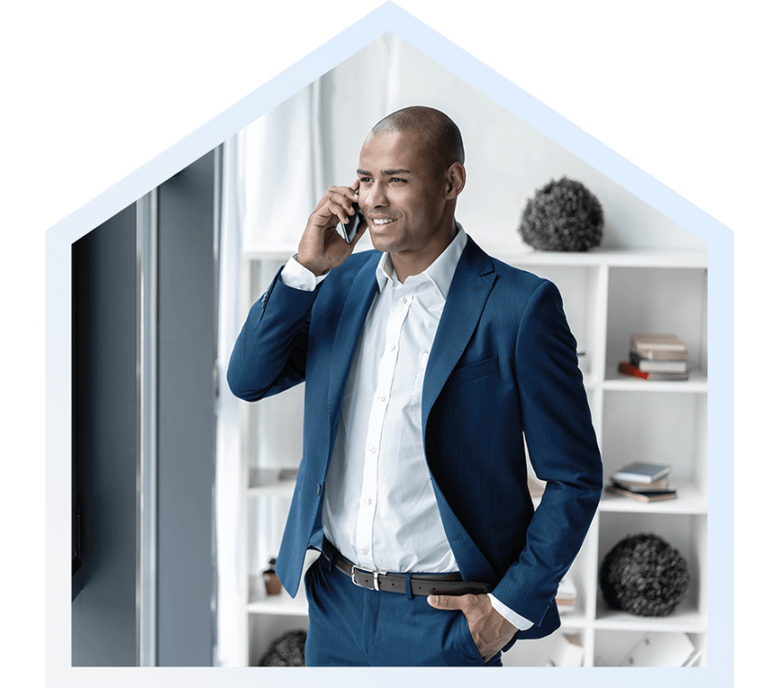 Professional Black man in suite on phone